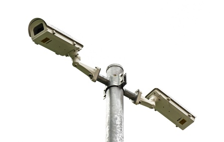 two cctv spy camera record on steel pole isolated on white background photo