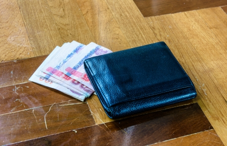 paquet: single black wallet with thailand money on brown paquet floor backhrounds Stock Photo
