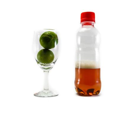 green lemon in wine glass with lemon tea bottle isolated on white background Stock Photo - 22846179