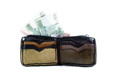 single old color leather brown wallet and thailand money isolated on white backhrounds photo