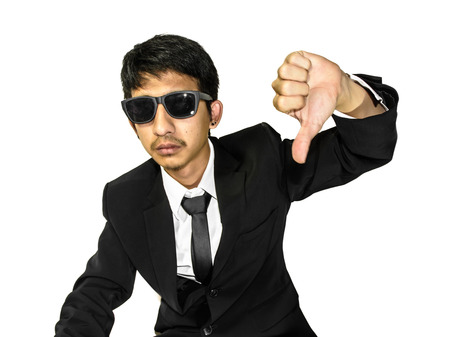 close up young asia businessman in suit a thump unlike isolated on white background photo