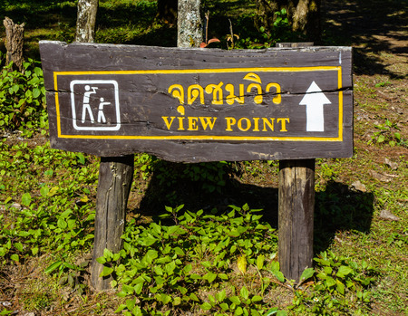 thai language: old wood view point sign pattern with thai language for torist at on public nature mountain Stock Photo