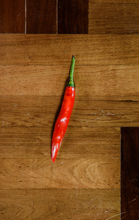 paquet: close up single big pepper in on brown wood paquet floor ground Stock Photo