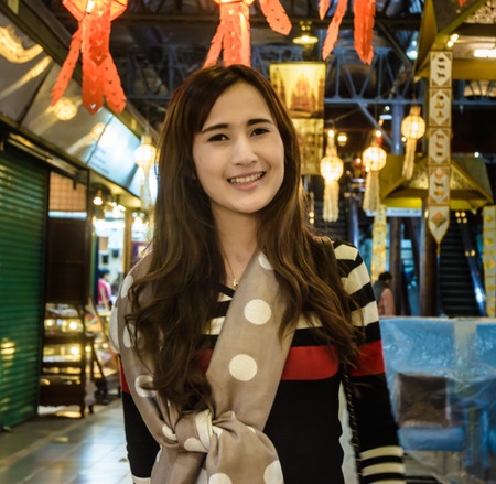 portrait Cute asia youn girl smile on nigt market city street photo