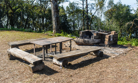 old table wood for picnic outdoor on natural mountain background photo