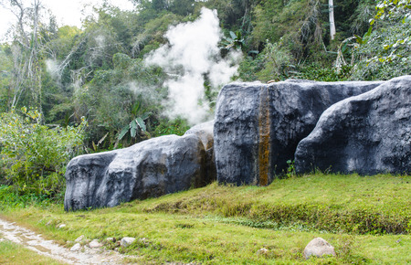 lot of smoke with Hot Spring Stream in big stone on forest natural thailand photo