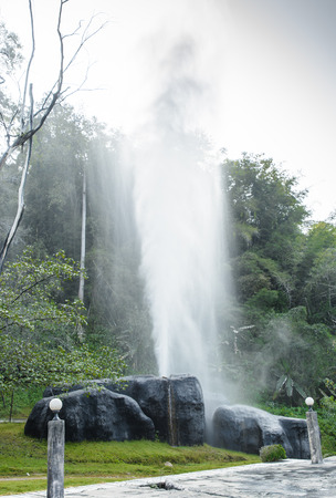 water Hot Spring Stream in big stone on green forest natural at mountain thailand photo