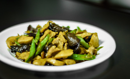 cow pea: Fried oil with pork, mushroom and cow-pea food on white dish