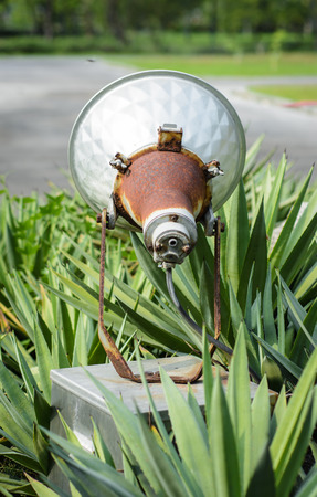 outdoor lighting: back view old outdoor  lighting with park natural background Stock Photo