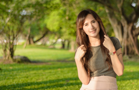 portrait asia young woman happy and smile at outdoor summer in natural garden photo