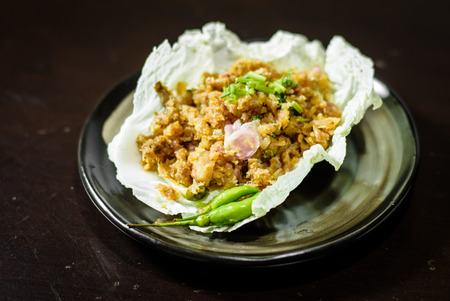 Spicy salad with pork and green herb with cabbage in Thai style food photo