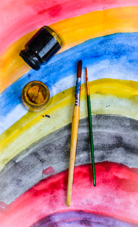 paintbrushes and color bottle for painting with paper background photo