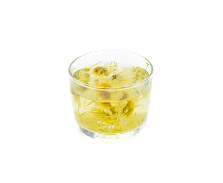 sweet chrysanthemum tea on glass isolatated on white.