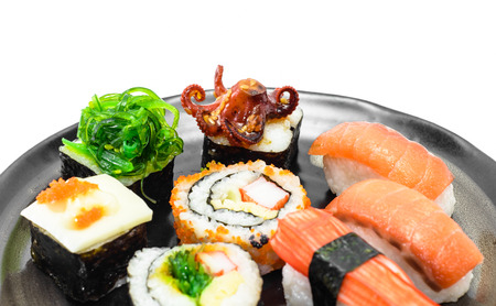 desert food sushi on black dish  isolated on white background photo