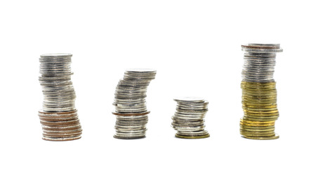 High pile of gold and silver coins thailand isolated on white background photo