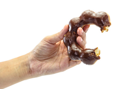 girl hand hold donuts food isolated on white background photo