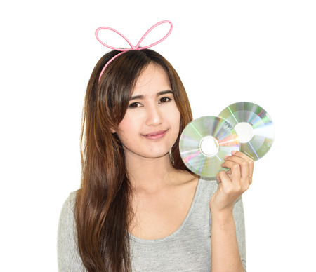 portrait cute asia young woman smile with DVD or CD  isolated on white background photo