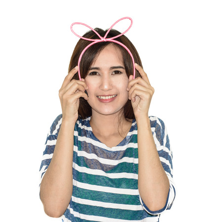 hairband: portrait asia girl wearing a pink hairband isolated on white Stock Photo