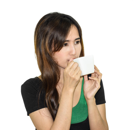 drowsiness: asia young Girl drink a coffee cup in hands isolated on white background