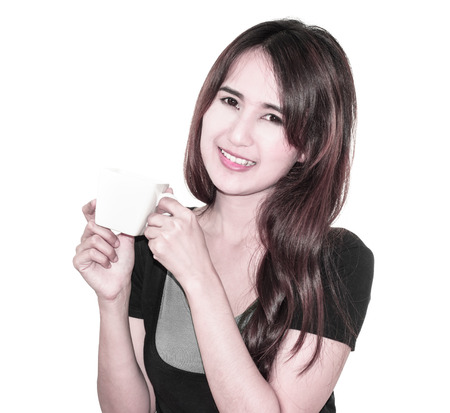 drowsiness: asia young Girl smile and drink a coffee cup in hands isolated on white Stock Photo