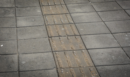 blinder: Blind peoples track. old street road pattern background Stock Photo