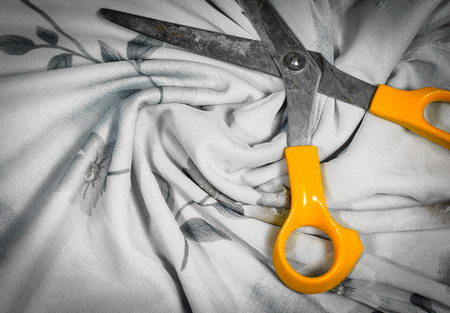 old scissors with textile fabric pattern detail background photo