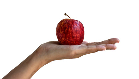 girl hand hold Red apple isolated on white  photo