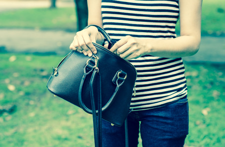 Young woman wear jeans and fashion bags with retro filter at outdoor natural on summer photo