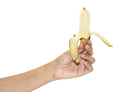 woman hand hold Ripe peeled banana isolated on white background photo