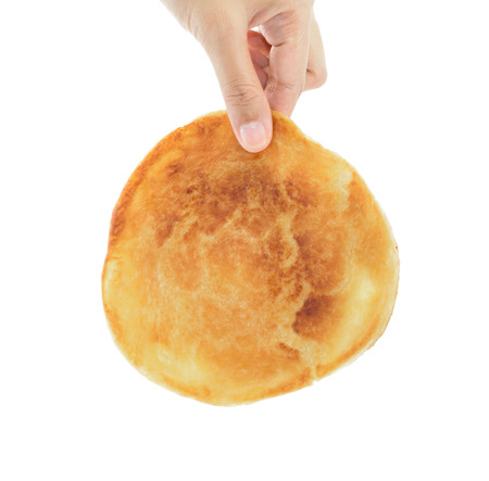 asian woman hand pick piece of pancake bread isolated on white background. photo