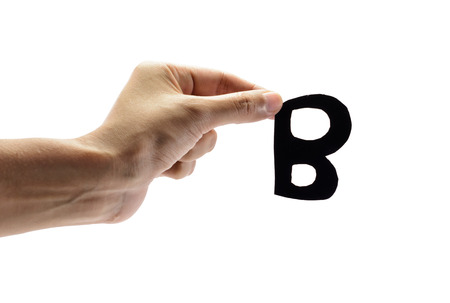 woman hand holding the black letter b, isolated on white background photo
