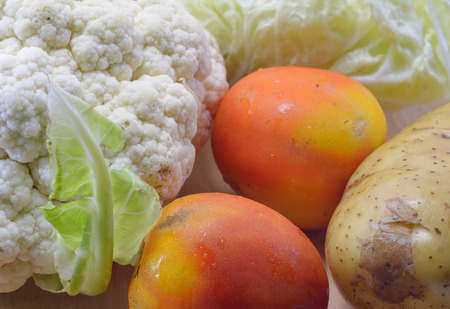 lot of Fresh vegetable at wood plate background photo