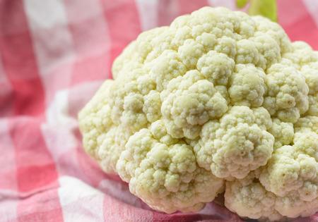 fresh Cauliflowers vegetable at fabric plaid pattern background photo
