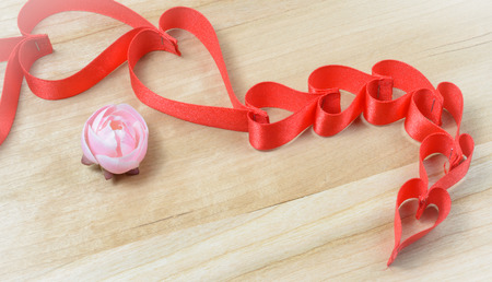 Ribbons red hearts shaped on wood background love concept photo