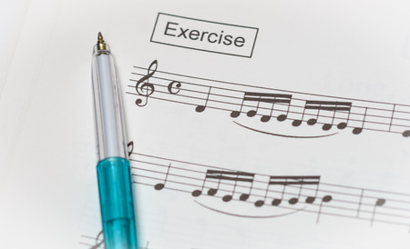 music notes paper and pen for pattern background photo