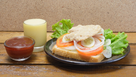 Sandwich and meat with vegatable at table background photo