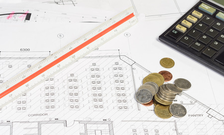 construction plans: interior work plan and object with coin money for business concepts