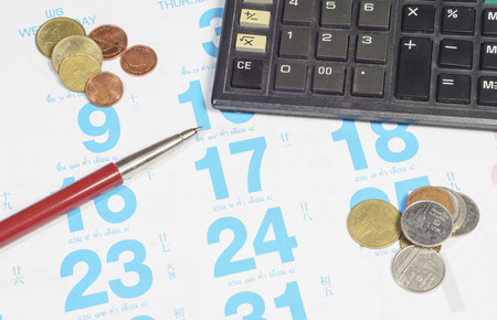 assignation: calendar for note, work with pen and coin Stock Photo