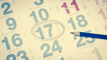 assignation: calendar for note, work with pencil wood with retro filter
