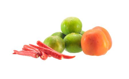 fresh vegetable tomatoes, lemon and pepper isolated on white photo