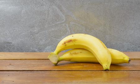 banana peel: ripe bananas fruit on wood table