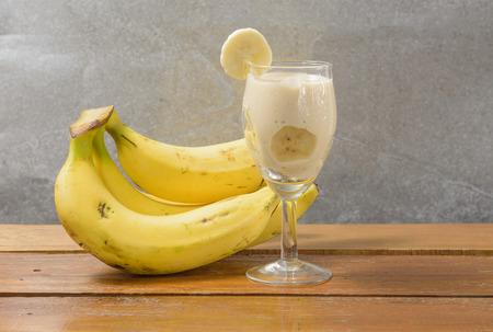 fruit Banana Smoothie drink on wood table photo