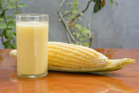 fresh corn cream drink on wood table photo