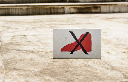 Do not step on sign on concrete floor at outdoor photo