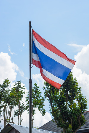Thailand flag on natural and blue sky background. photo