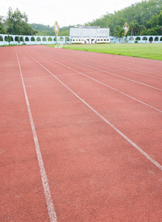 grunge Running track in old public stadium photo