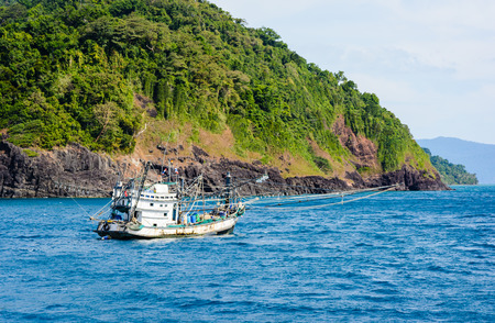 old Thai fishing boat used as vehicle in the sea natural at koh chang ,Thailand photo