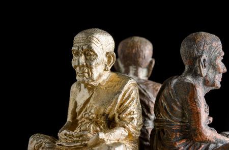 close up old small buddha amulets of Buddhism religion photo