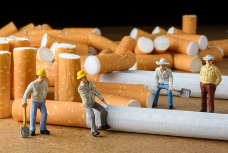 butt: cigarette butt and man miniatures workers with select focus