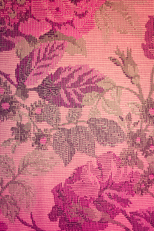 interweaving: flower fabric pattern texture background with retro filter